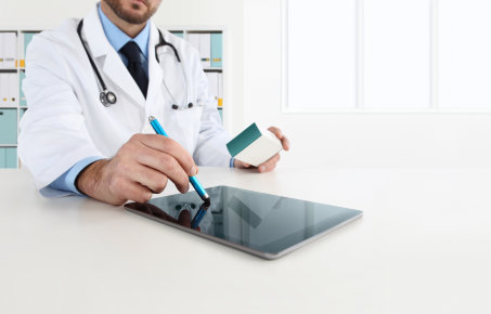Doctor working on a tablet