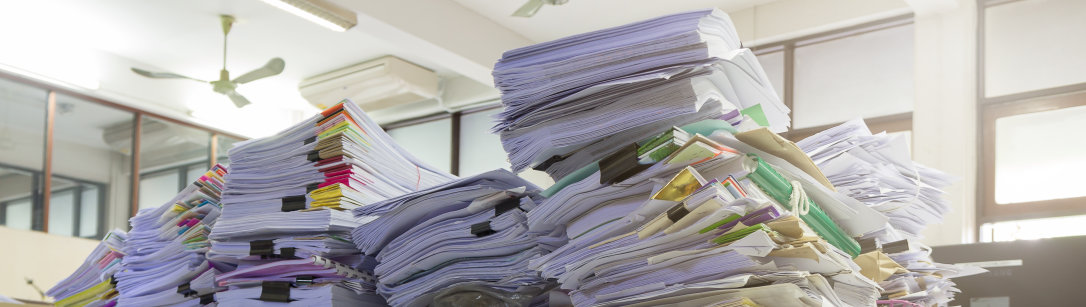 Piles of documents on a desk