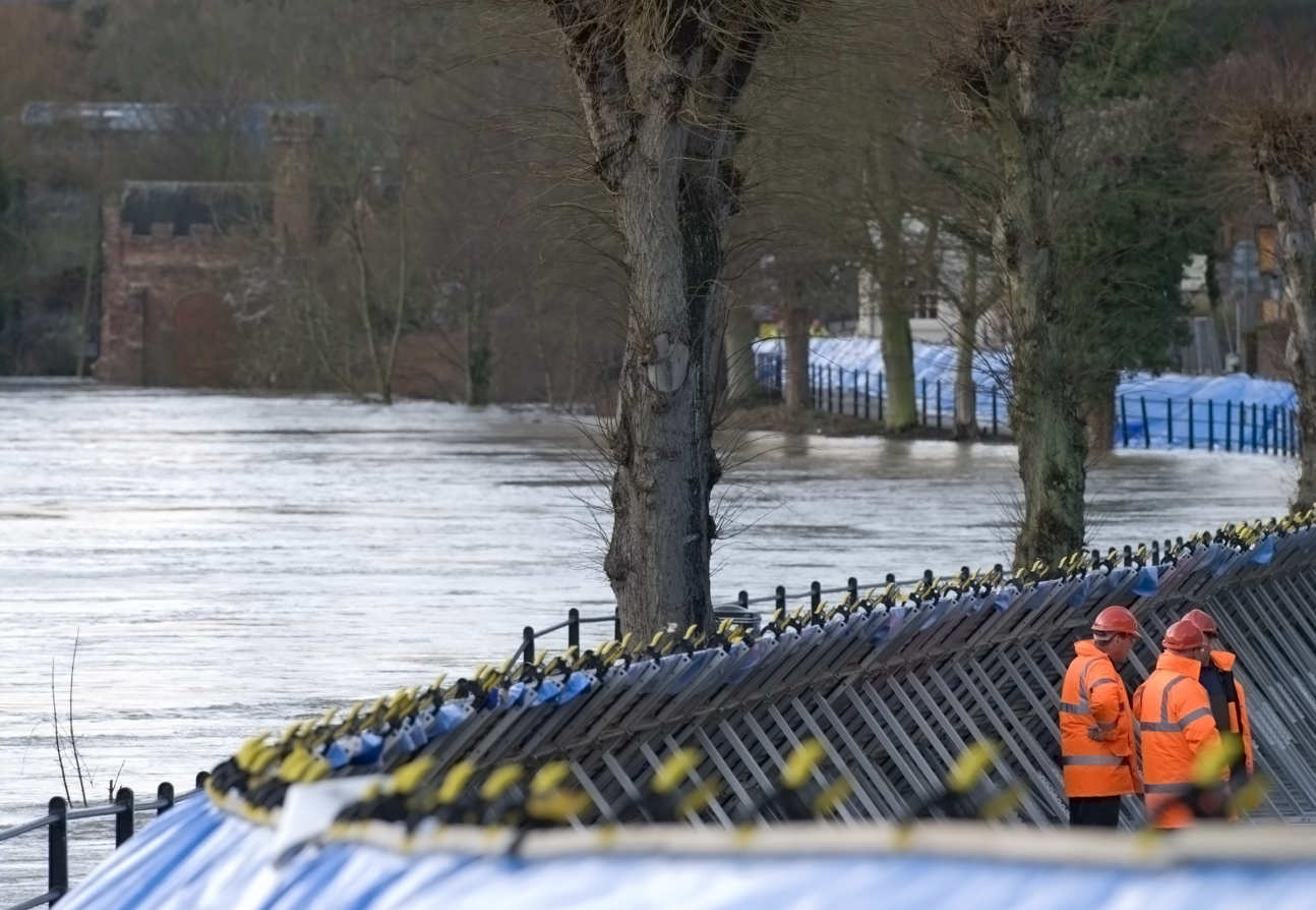 An image of temporary flood defences along a river