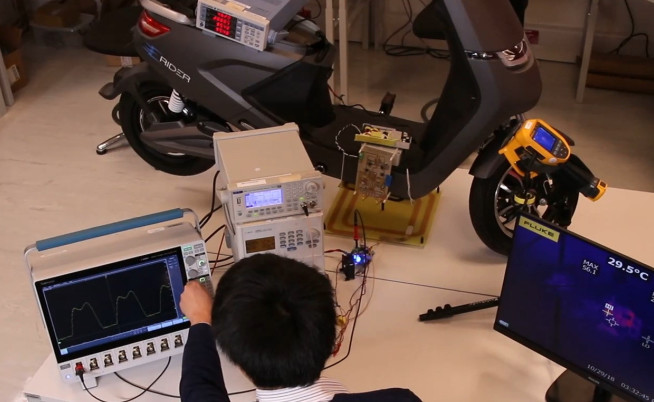 (Image: Testing a ride -on scooter wireless charger in the Wireless Power lab )