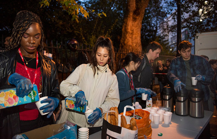 Members of the Soup Run Society serving drinks outside Lincoln's Inn Fields in London