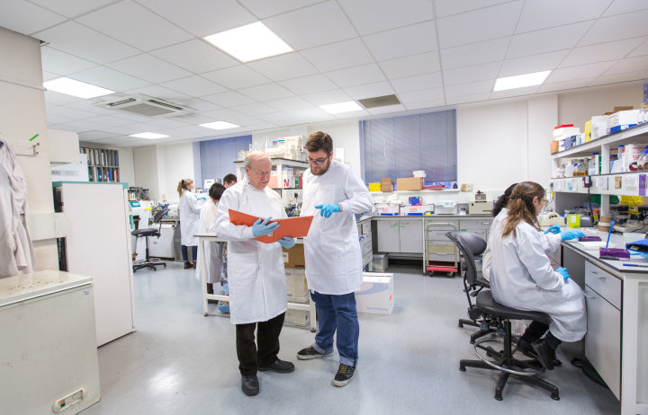 Image of a research team working in a lab