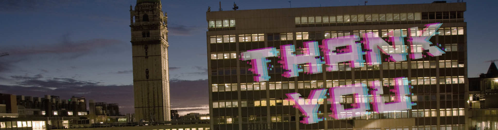 thank you projected on the EEE building