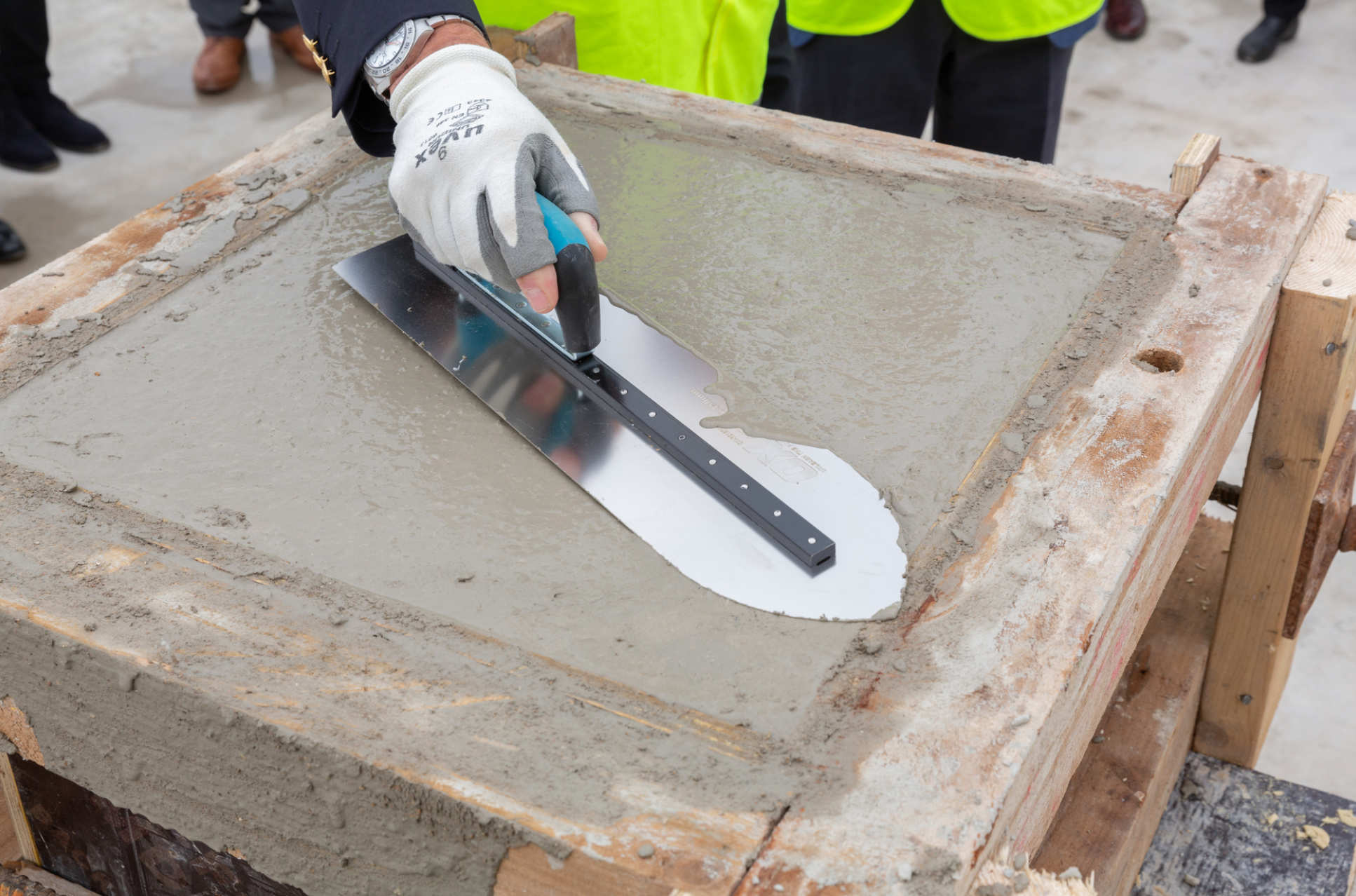 Trowel smoothing out concrete