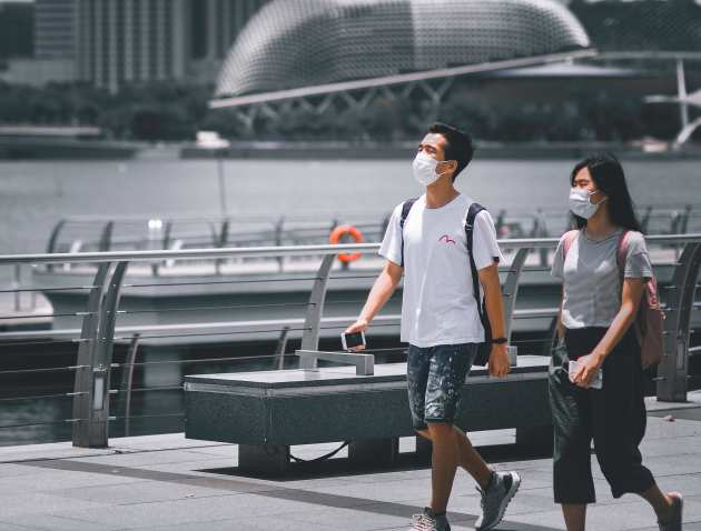 Two people wearing face masks