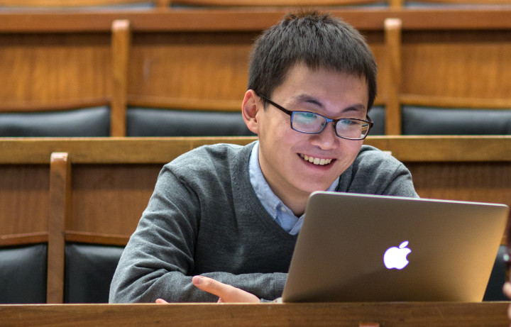 Student smiling in lecture room
