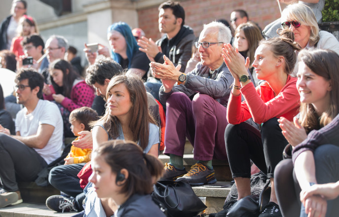 Visitors watching a performance