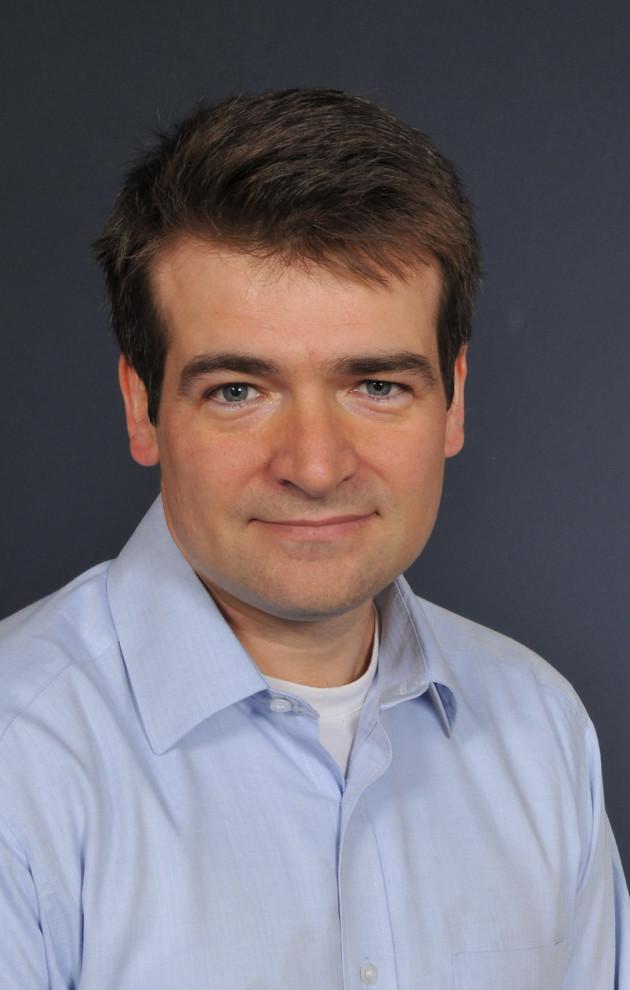 White man in blue shirt - portrait