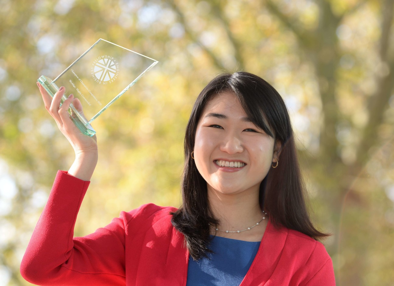 Innovation Design Engineering student WuQing Hipsh holding her award
