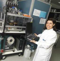 Dr Moraes stands in front of the crystal incubator