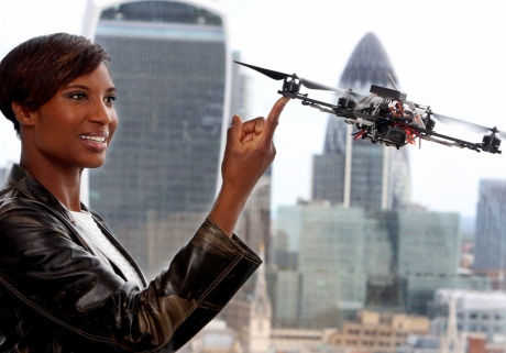 Skoolbo Ambassador and former Olympic Heptathlete Denise Lewis with one of the aerial robots