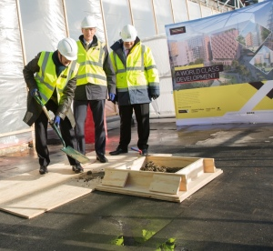 Professor David Gann lays the final cement in the constuction of the Translation and Innovation Hub