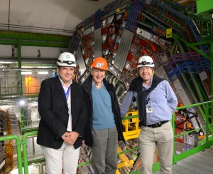Sir Tom (Centre) visits colleagues at CERN