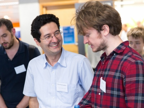 Dr Ed Johns speaks with Dr Petar Kormushev at the UK Robot Manipulation Workshop