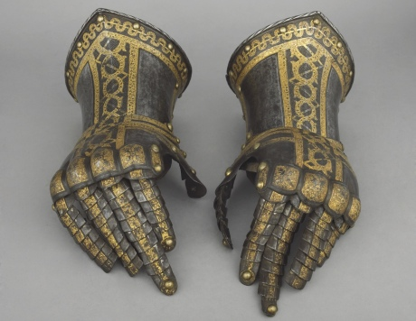 A pair of ornate 16th century gauntlets