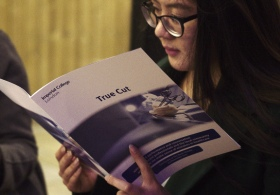An audience member reading the programme