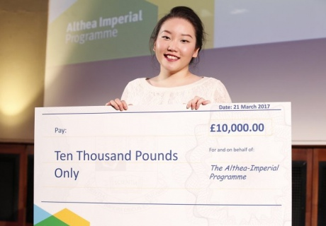 Medical student Olivia Ahn holding her cheque for £10,000