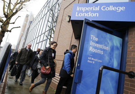 Diplomats enter the invention rooms throuhg a branded front door
