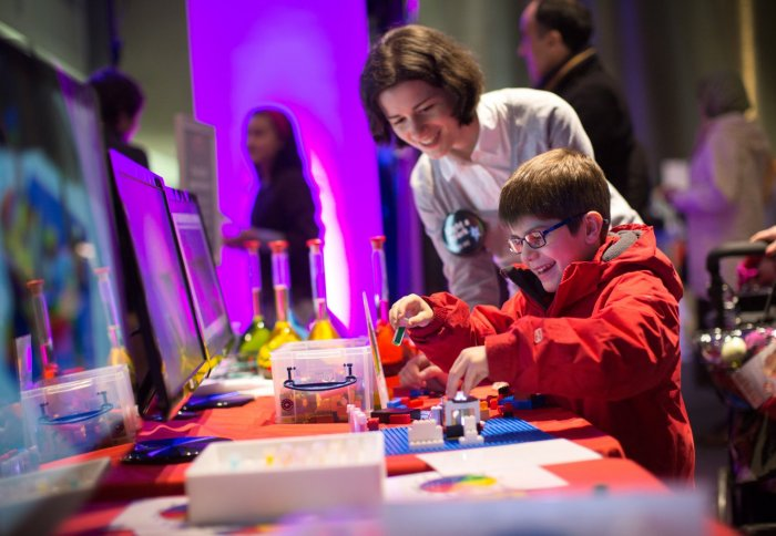 child plays with LEGO spectrometer at the Fringe