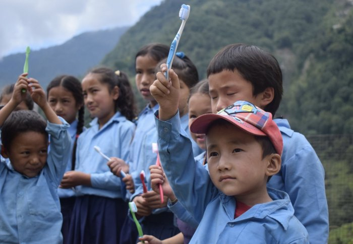 Handing toothbrushes out in rural Nepal