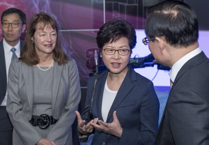 Carrie Lam with Professor Guang-Zhong Yang and President Alice Gast