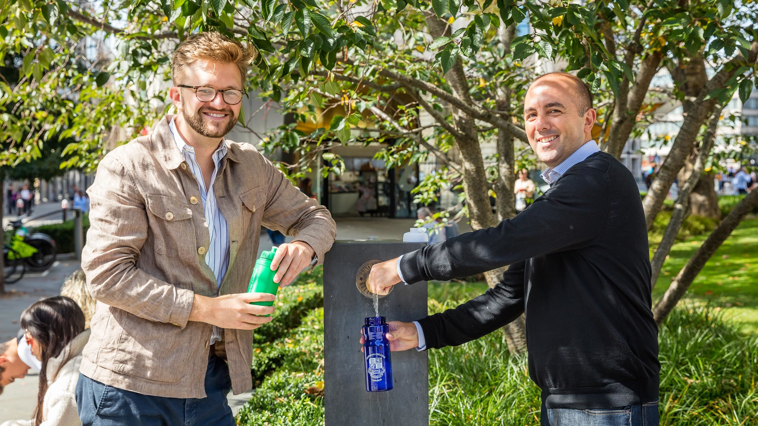 Dr Weston Baxter and Dr Marco Aurisicchio using a water refill point in the City of London
